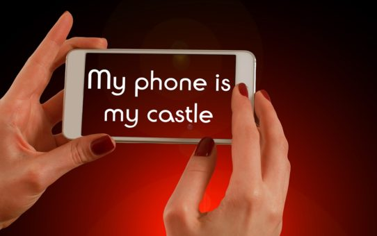 "cell phone that says ""my phone is my castle"" on the screen"