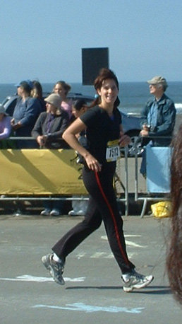 woman at race finish line